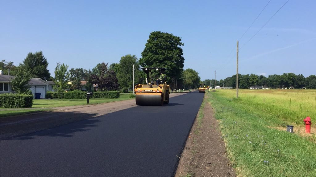 road paving with an asphalt rubber mix – thin overlay – made with RARx additive